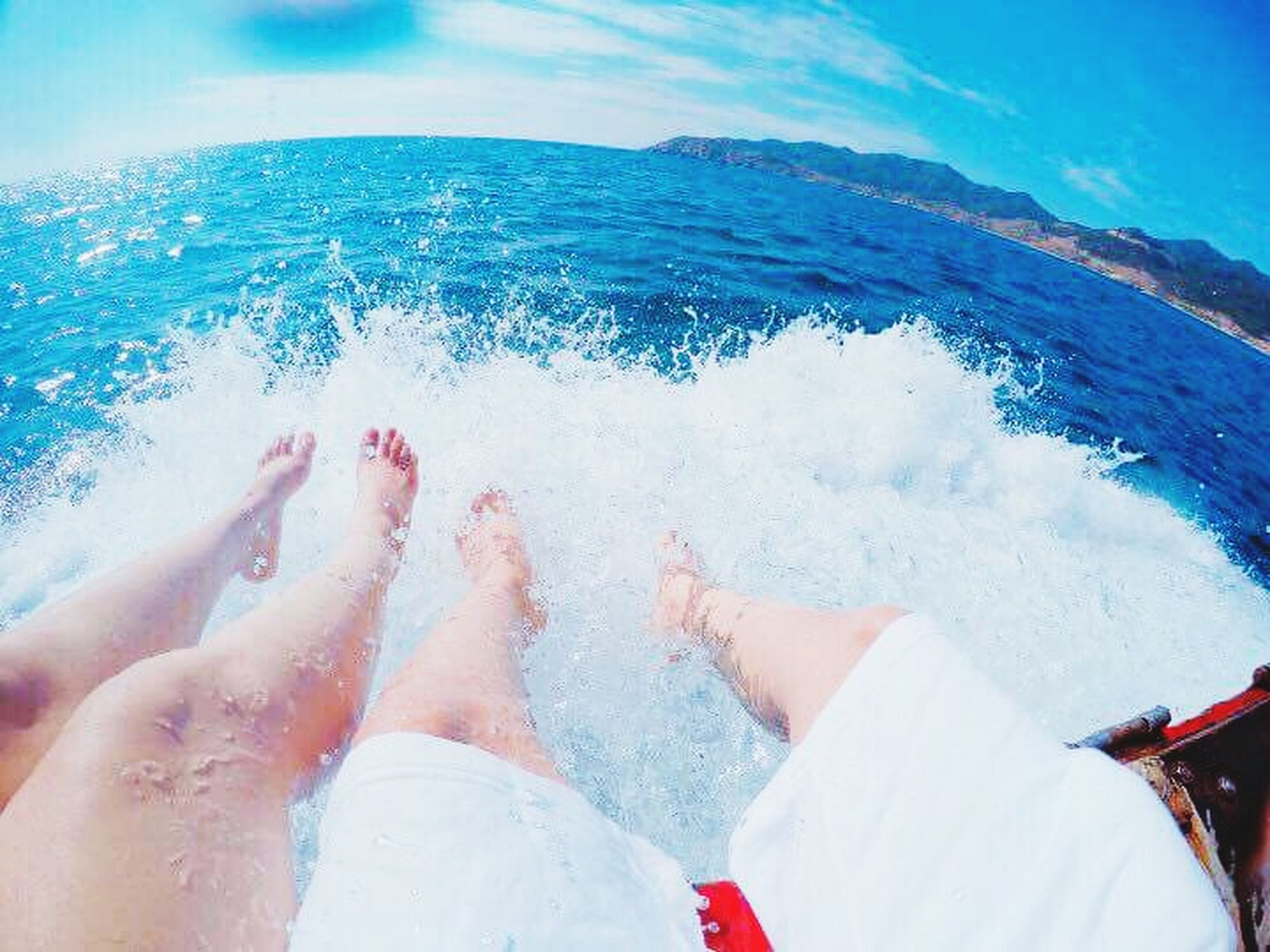 water, sea, motion, barefoot, human body part, leisure activity, vacations, blue, two people, fun, outdoors, togetherness, low section, wave, relaxation, day, swimming pool, beach, women, adult, men, horizon over water, close-up, people, nature, sky, adults only