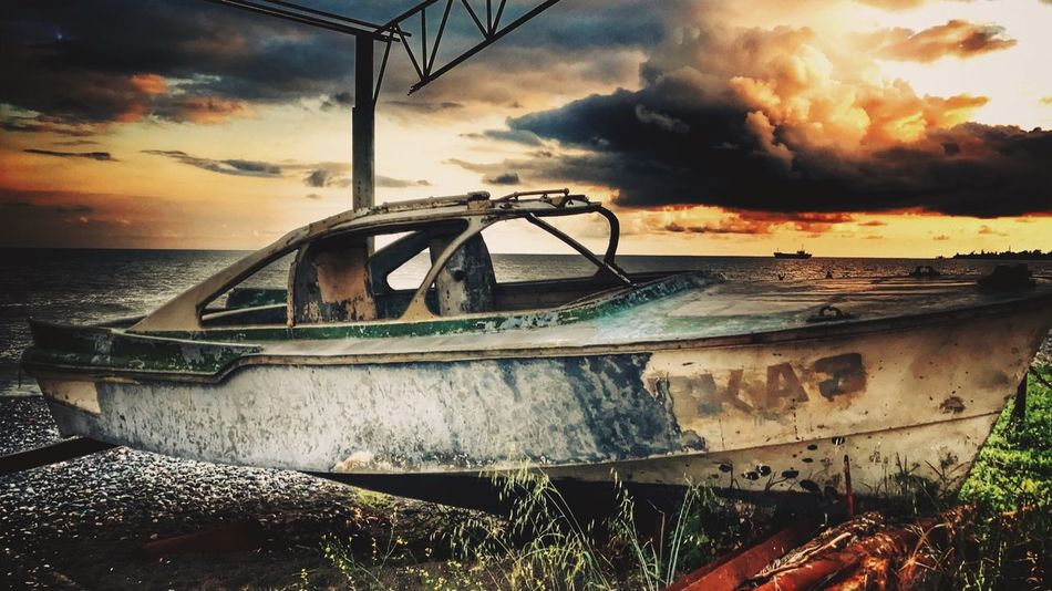 Abandoned Beach Beauty In Nature Boat Cloud - Sky Damaged Mode Of Transport No People Obsolete Sea Sky Sunset Tranquil Scene Wrecked Boat.