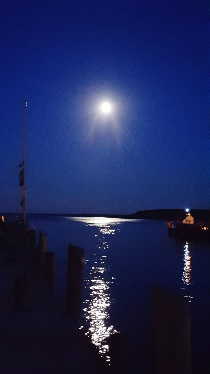 moon, water, sun, beauty in nature, nature, reflection, sea, sky, scenics, no people, moonlight, clear sky, outdoors, illuminated, tranquility, horizon over water, astronomy
