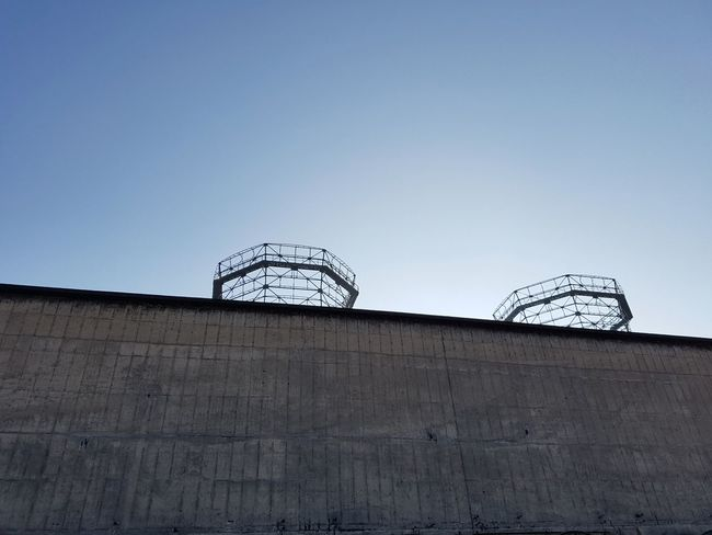 Minimalism Clear Sky Built Structure No People Architecture Futuristic Science Vintage Objects Industry Full Frame Winter Sunlight Building Exterior Abandoned Steelwork Facades Factory Rusty Adapted To The City Round Objects Technology Architecture Steel Old Buildings Lines The Architect - 2017 EyeEm Awards