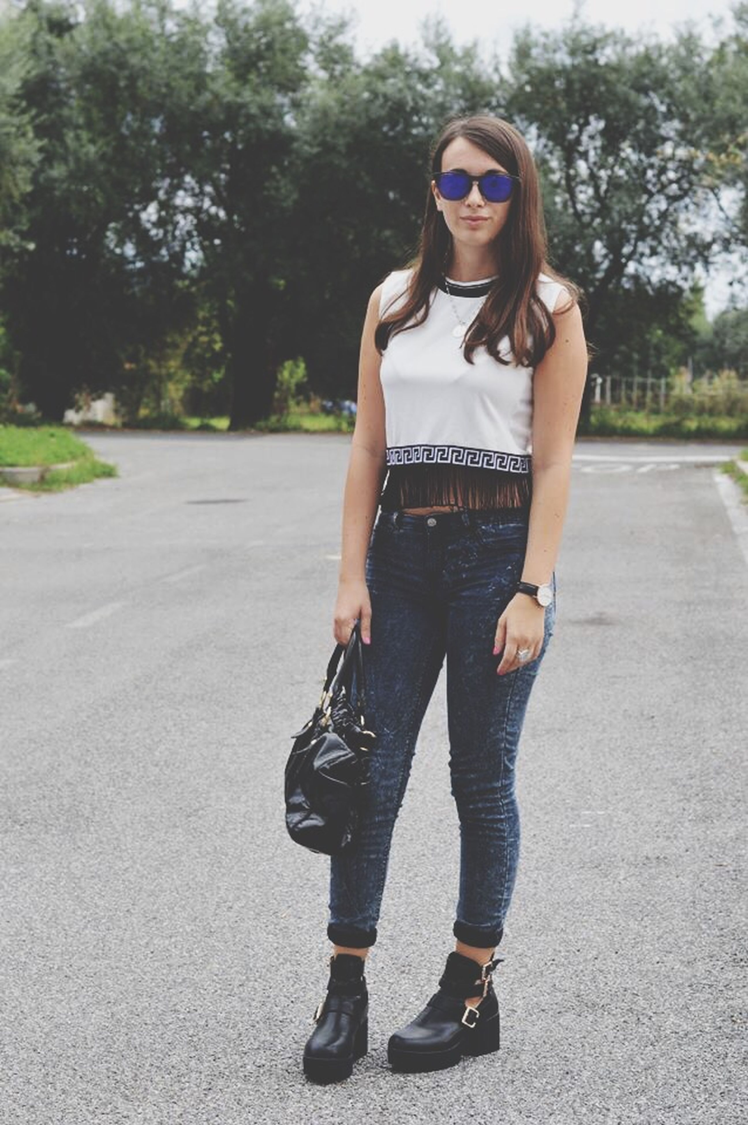 young adult, lifestyles, casual clothing, person, full length, young women, leisure activity, front view, standing, tree, looking at camera, fashion, portrait, road, street, sunglasses, long hair
