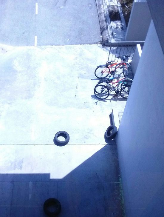 Bicycle Blue Purple Calm Tyres Road No People Looking Down Looking Through Window Original Experiences Showcase June The OO Mission Hidden Gems  Athleisure Colour Of Life Color Palette A Bird's Eye View The Color Of Sport Dramatic Angles CyclingUnites The City Light Flying High
