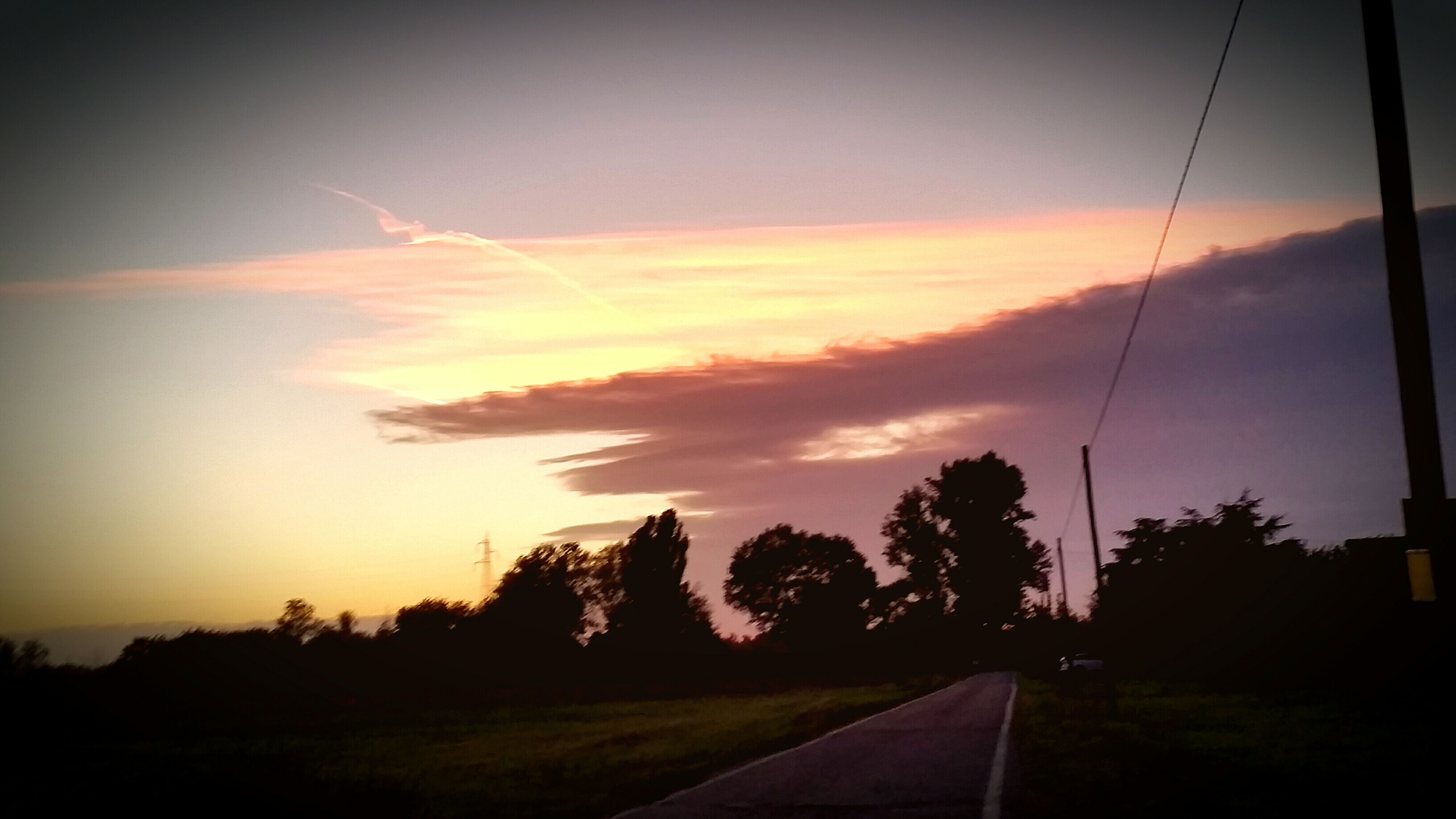 sunset, sky, tree, silhouette, road, transportation, tranquil scene, scenics, tranquility, beauty in nature, nature, landscape, cloud - sky, orange color, the way forward, cloud, idyllic, country road, no people, diminishing perspective
