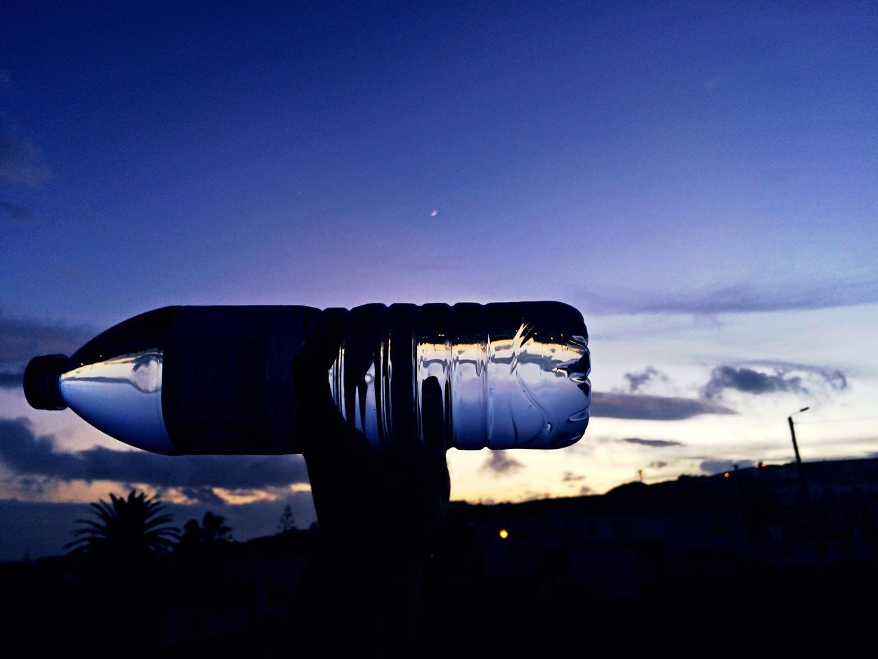 Sky Blue Cloud - Sky Outdoors Human Body Part Hand Colors Water Bottle Reflection Transparent Tranquility Tranquil Scene Sunset Sunset_collection Sunlight Sun