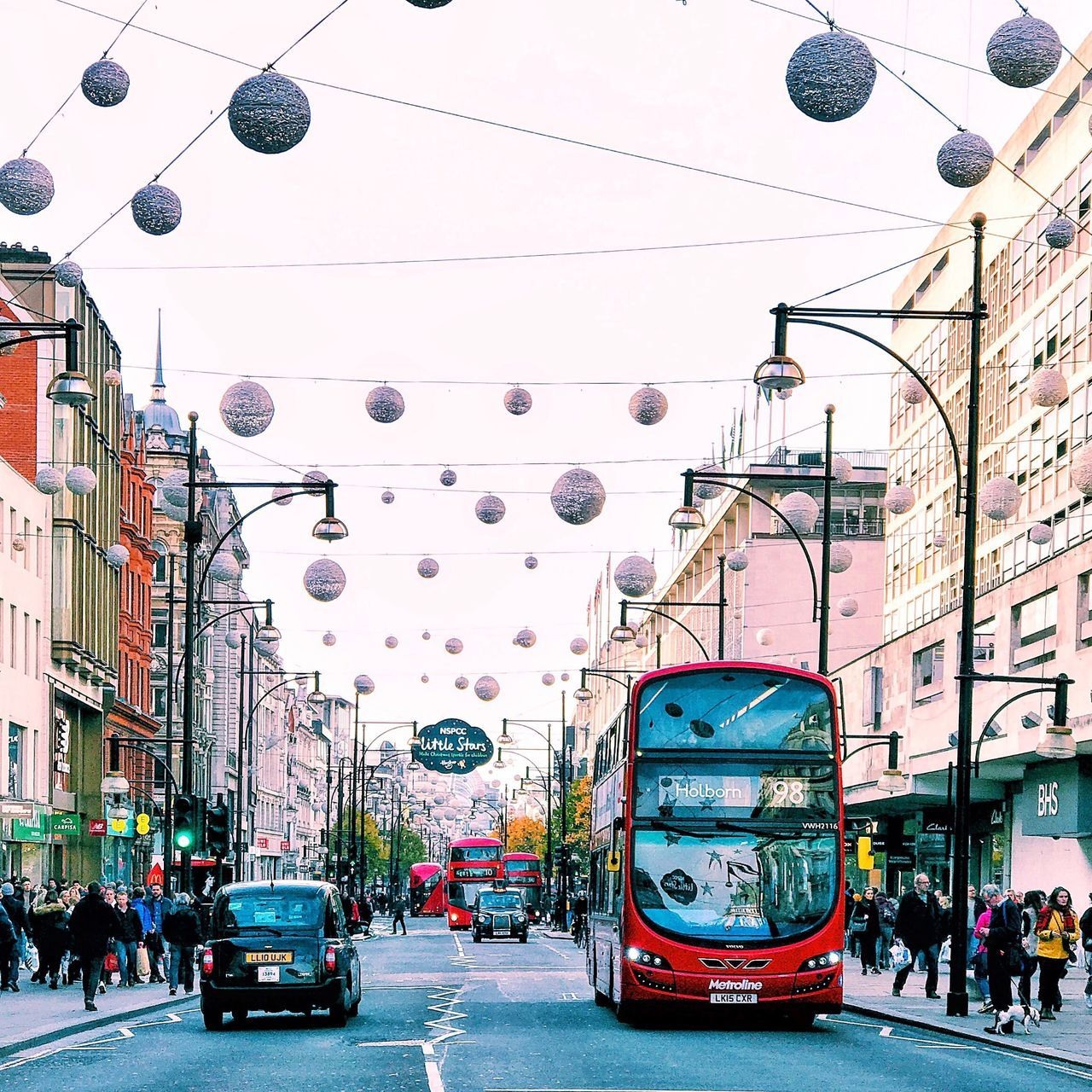 Xmas vibes in London ✨ City City Street Street Architecture Transportation City Life Building Exterior Cable Car Hanging Travel Destinations Built Structure Outdoors Public Transportation Red Light Day People Sky London Saturday Decoration EyeEm Best Shots EyeEm Gallery EyeEmBestPics Eyemphotos