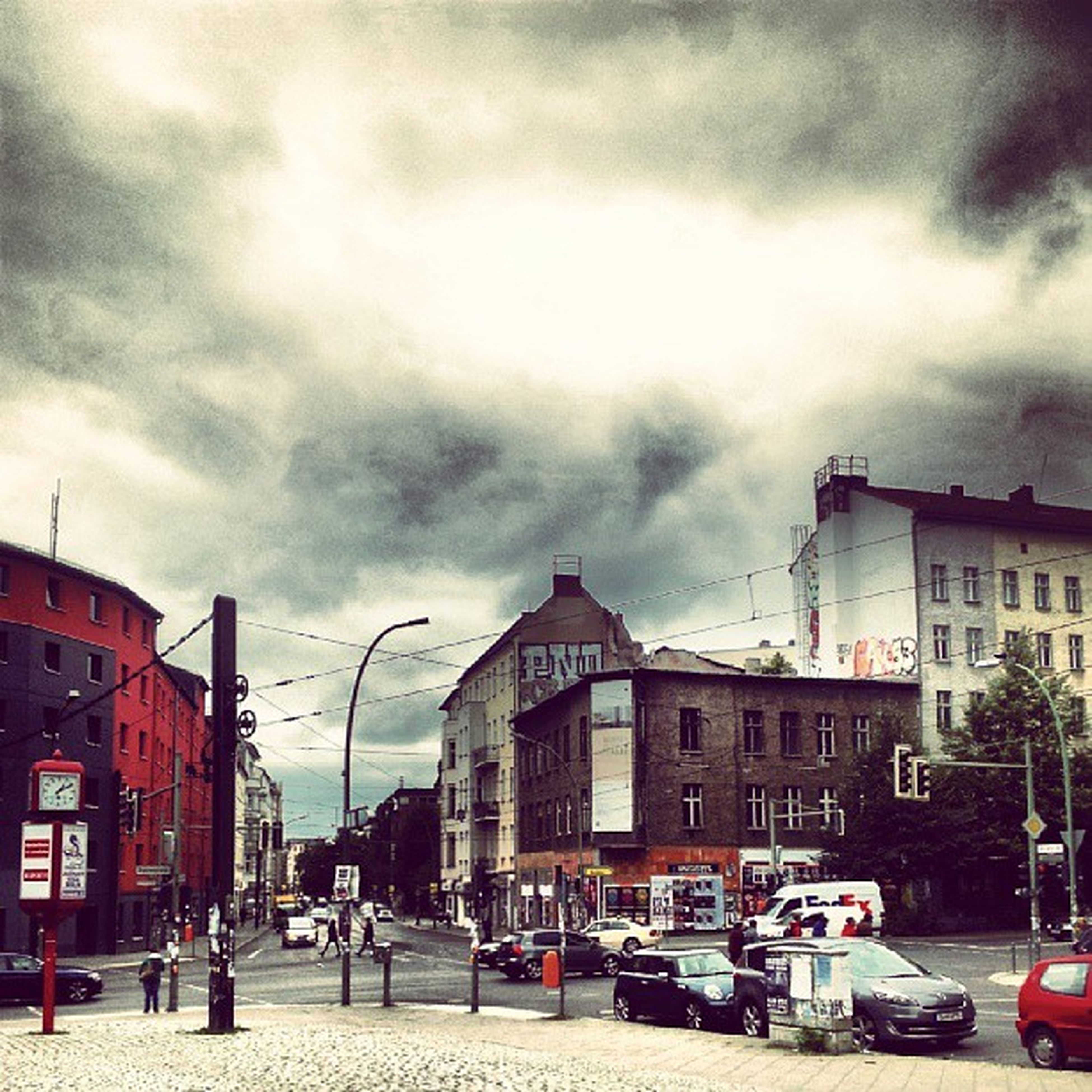 building exterior, architecture, built structure, sky, car, transportation, land vehicle, cloud - sky, street, mode of transport, cloudy, road, city, cloud, parking, street light, parked, residential building, house, incidental people