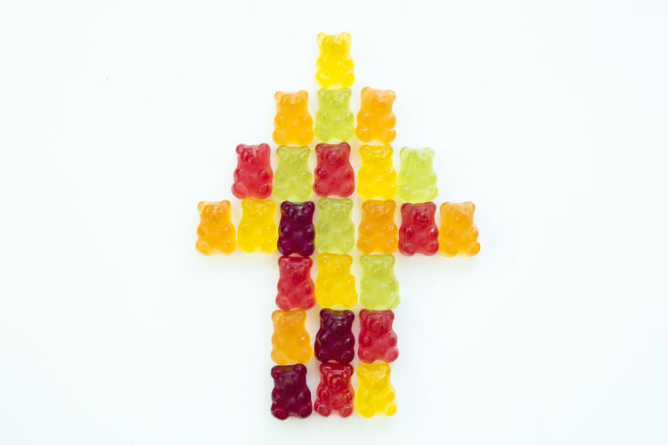 Detail of group of gummy bears composing an arrow in isolated background Bear Composition GummyBear Arrow Sign Arrow Symbol Backgrounds Candy Colorful Delicious Goodies Gummy Gummy Bears Gummybears Jelly Sweets Wallpaper White Background White Isolated