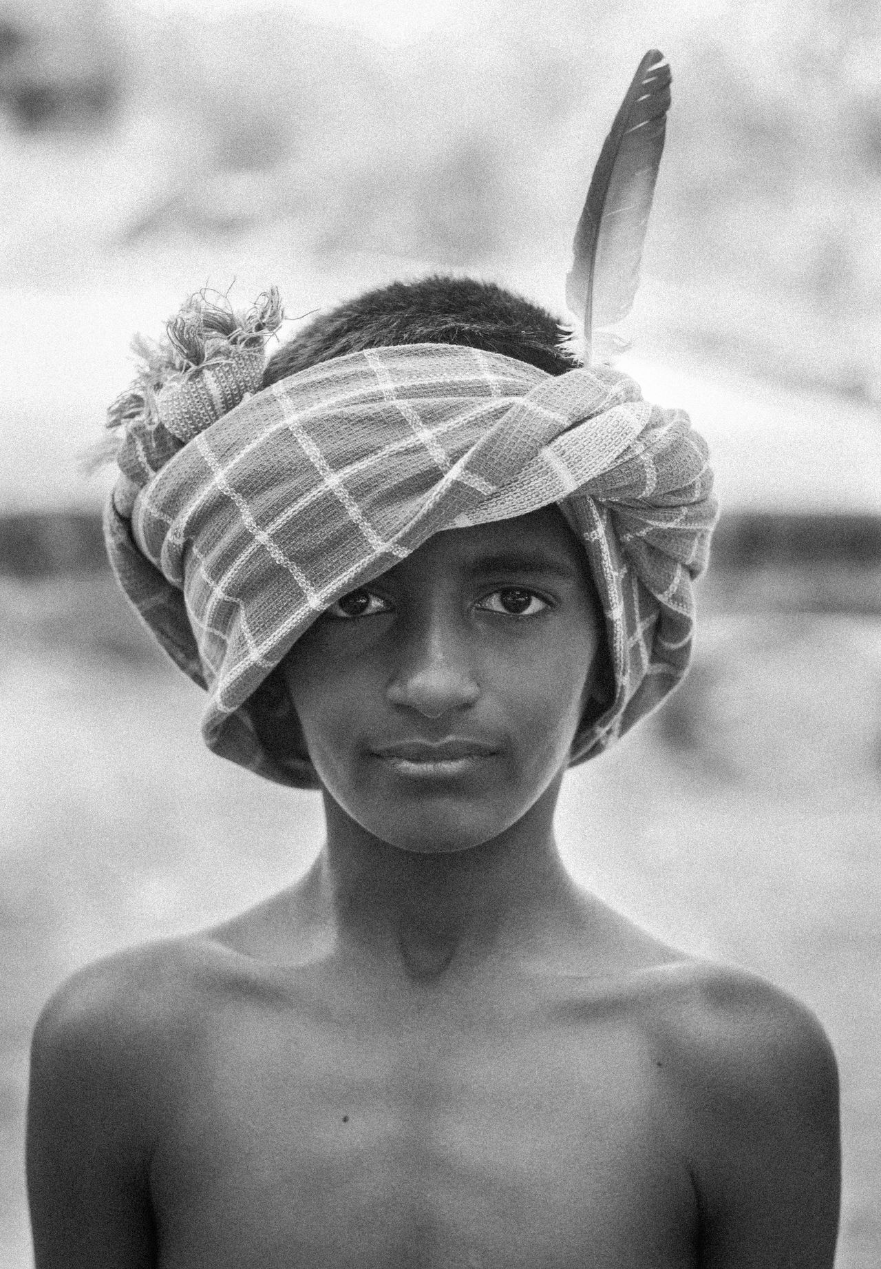 Black And White Blackandwhite Bnw Boy Close-up Countryside Day Farmer Feather  Live For The Story Lone Ranger Monochrome One Person Outdoors People Poor  Potrait Real People Rural Tonto Tribes Village