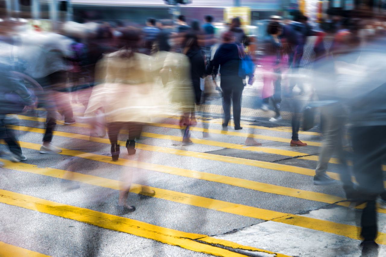 Conceptual motion blur picture of people crossing the street in a big city Blurred Motion Business City City Life City Street Commuter Crosswalk Crowd Crowded Defocused Downtown District Illuminated Large Group Of People Long Exposure Motion Outdoors Pedestrian People Rush Hour Speed Street Traffic Urgency Walking Women