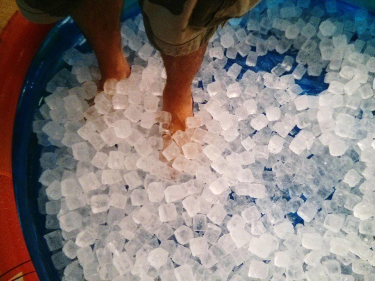 Man Standing On Ice Cubes