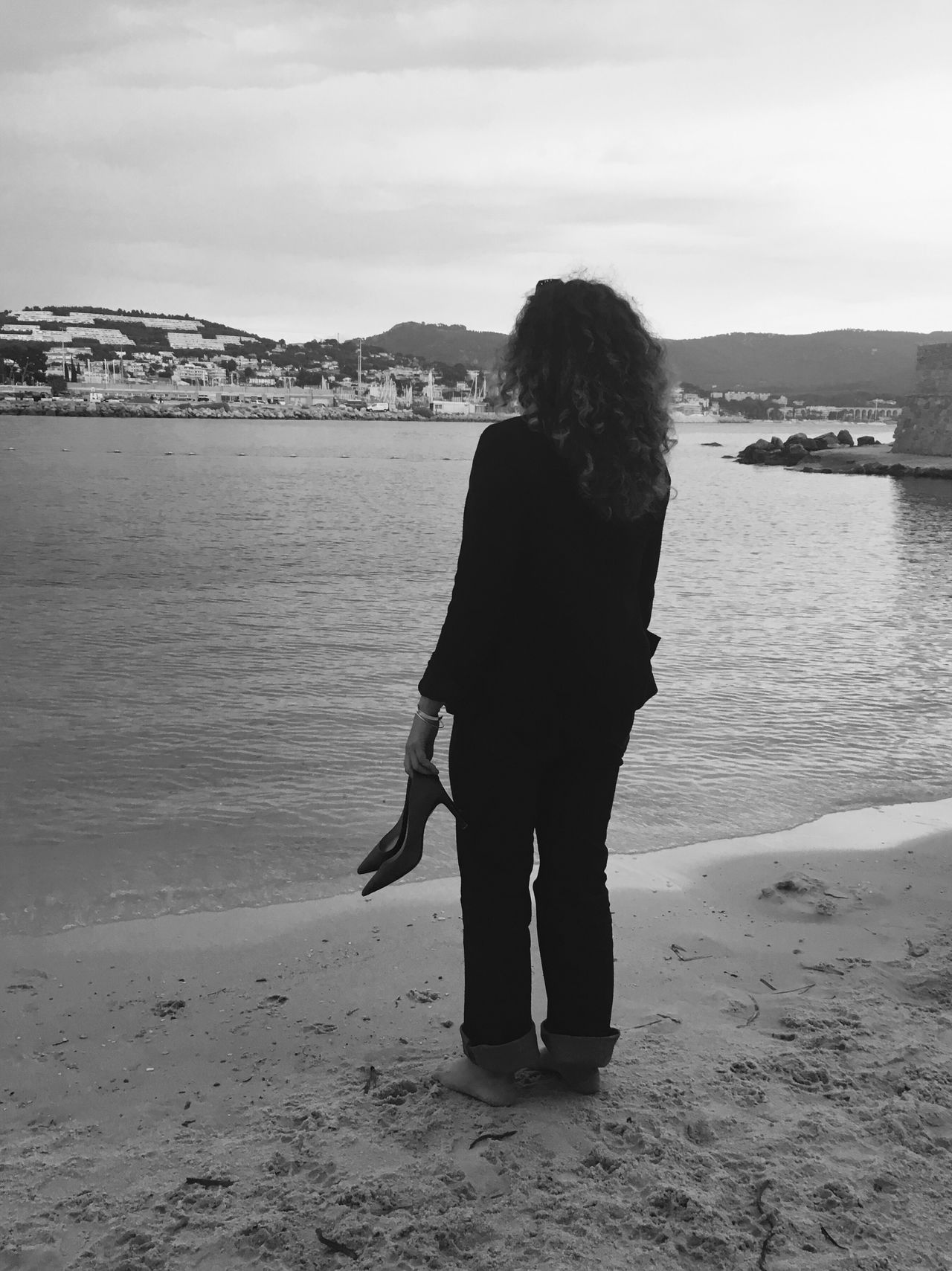 She's waiting... Rear View Beach Sea Standing Full Length Water Person Tranquility Shore Tranquil Scene Remote Idyllic Sky Solitude Scenics Calm Long Hair Nature Vacations Alone Monochrome Photography Snap A Stranger