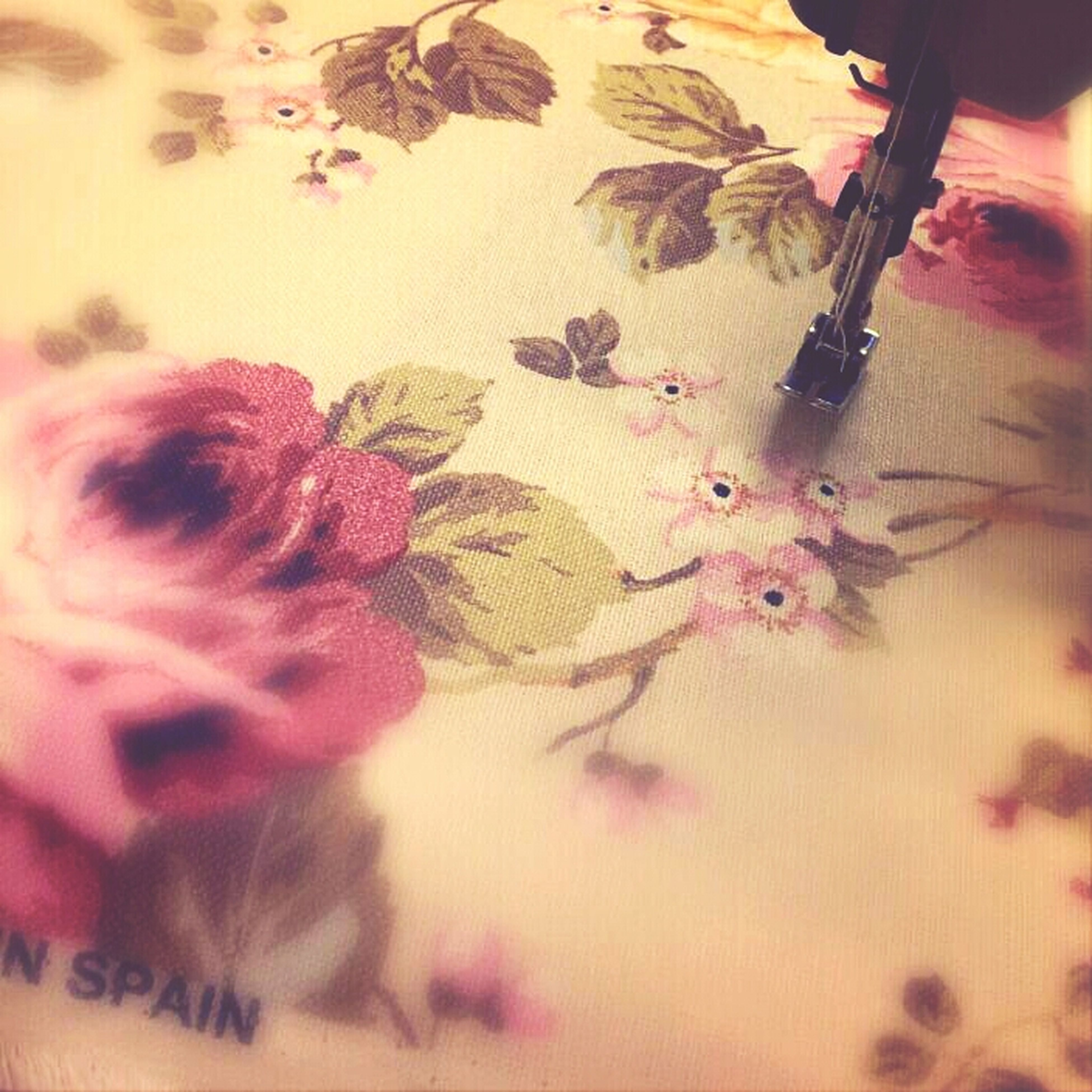 indoors, high angle view, close-up, table, floral pattern, creativity, home interior, art and craft, bed, pink color, art, messy, part of, textile, fabric, still life, person, selective focus