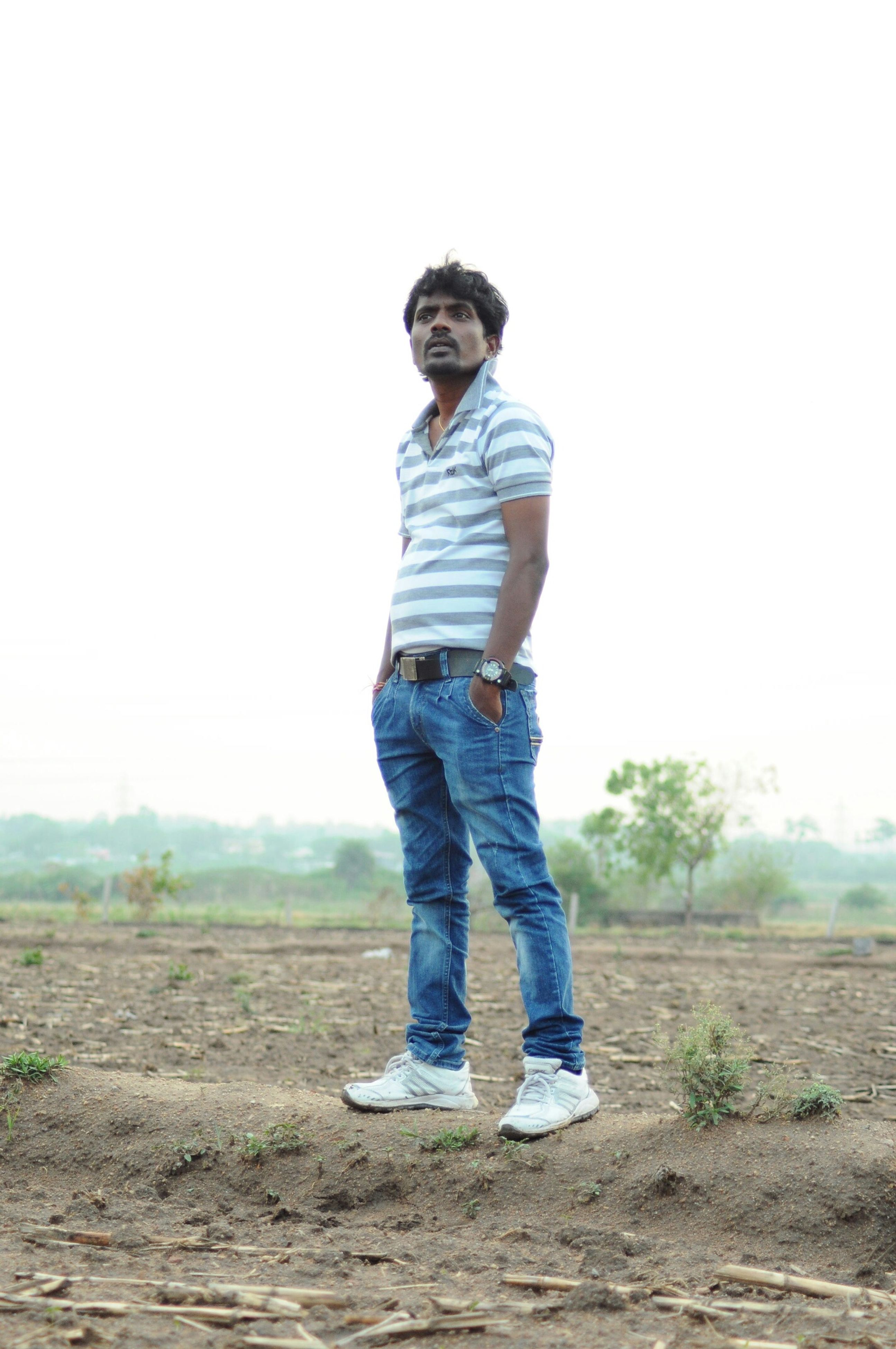 full length, casual clothing, lifestyles, standing, leisure activity, childhood, rear view, field, clear sky, person, landscape, front view, boys, sky, elementary age, day, copy space, nature