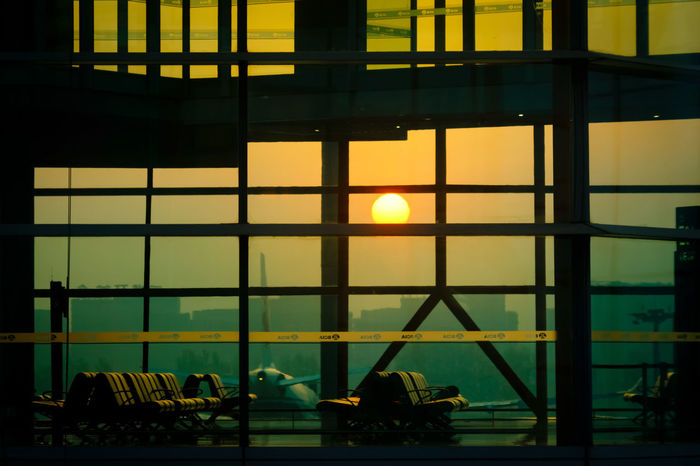 Sunrise, which is no small thing Beijing EyEmNewHere Mobility In Mega Cities Sunrise Silhouette Travel Travel Photography Airplane Airport Architecture Built Structure Canon China Day Illuminated Indoors  Nautical Vessel Pekin People Sky Sunrise Sunset Transportation Viajes