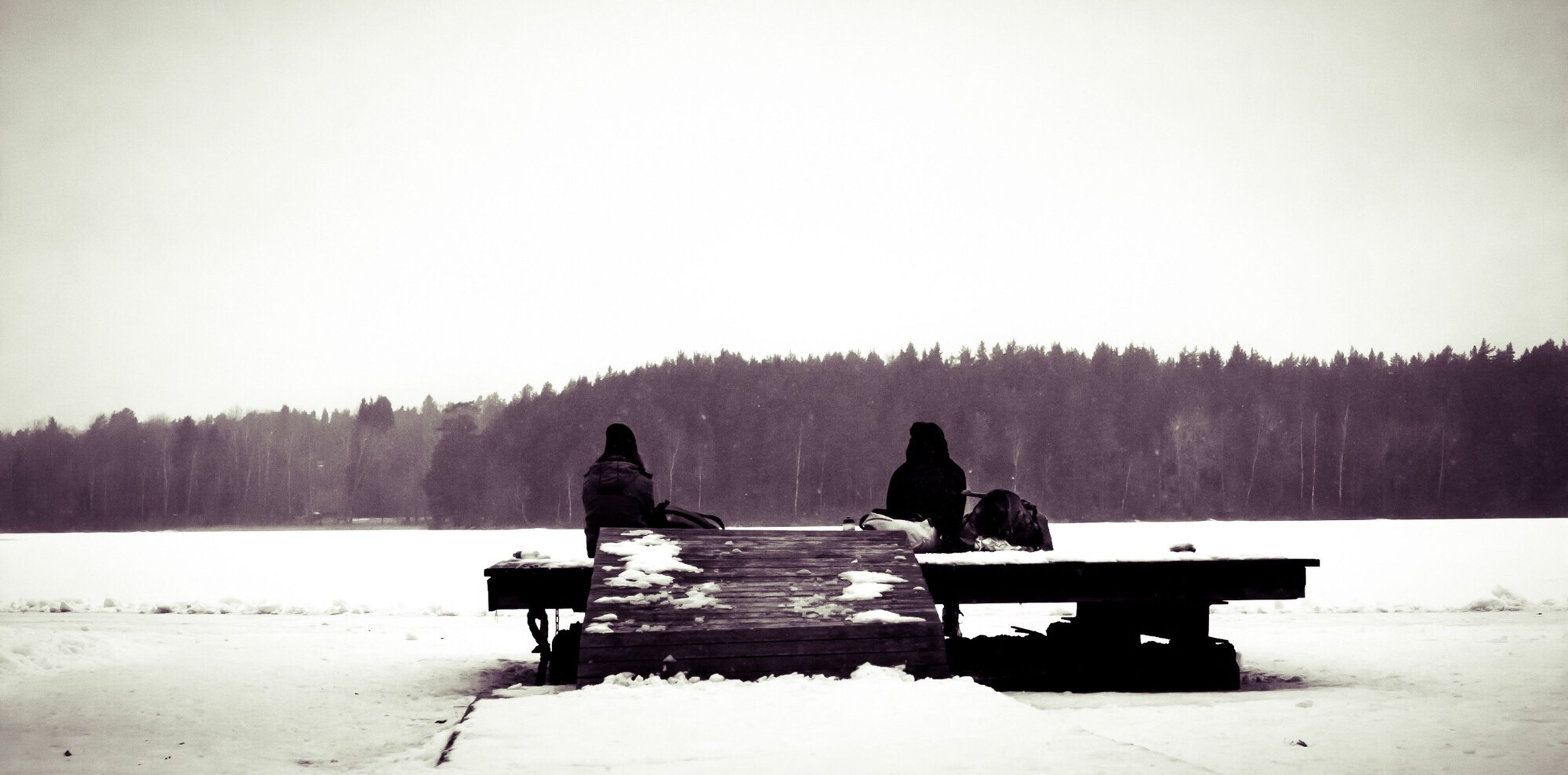 snow, winter, cold temperature, clear sky, tranquil scene, tranquility, copy space, bench, sitting, lake, silhouette, nature, season, scenics, beauty in nature, relaxation, water, weather, men