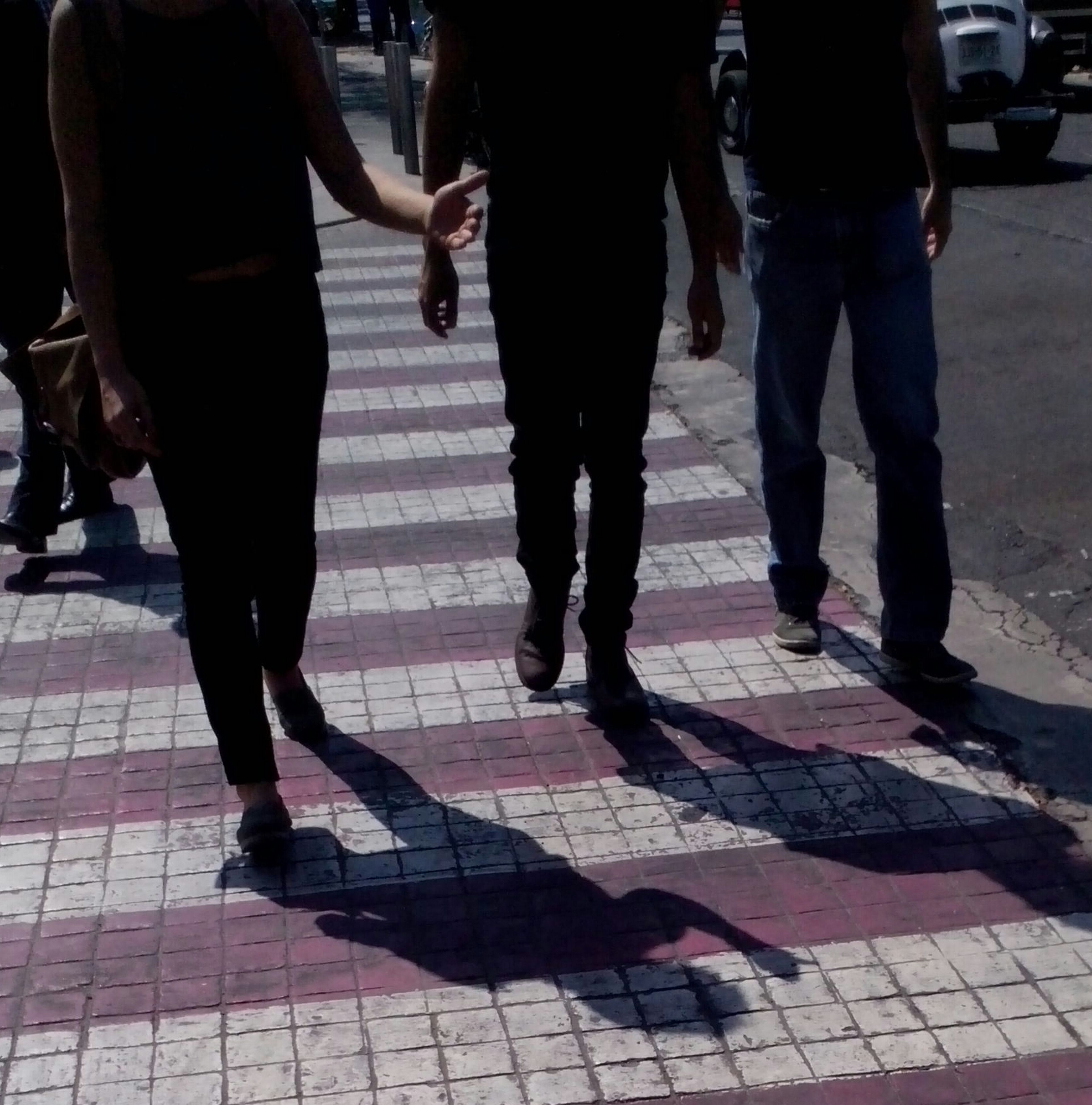 men, street, lifestyles, person, low section, walking, city life, togetherness, leisure activity, shadow, standing, sidewalk, medium group of people, large group of people, sunlight, city, footpath
