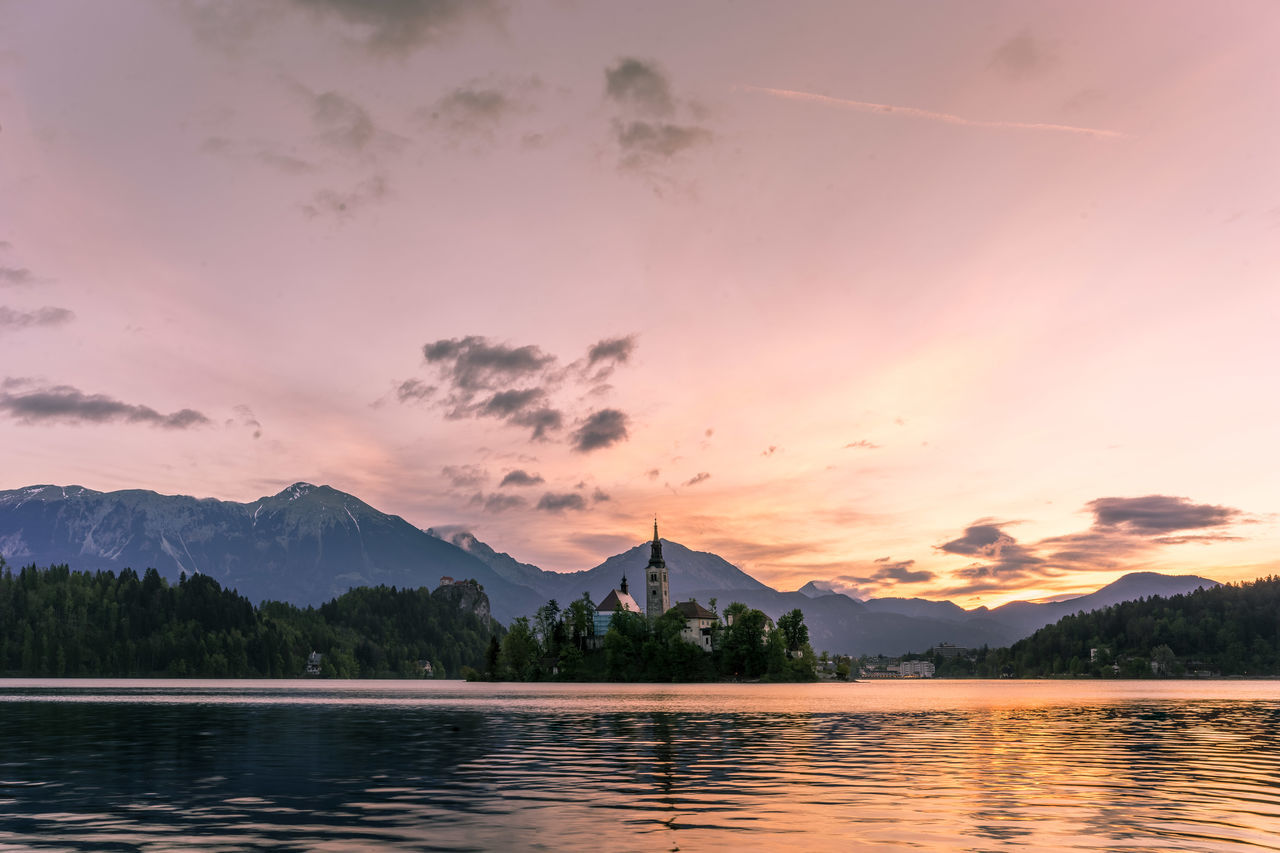 Sunrise over Lake Bled against the backdrop of the Julian Alps. Bled Bled, Slovenia Cloud - Sky Julian Alps Lake Mountain Mountain Range Outdoors Reflection Scenics Sky Slovenia Sunrise Tree Water Waterfront