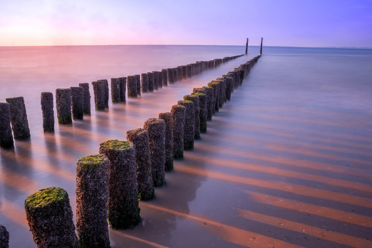 I personally think this is my best shot :) Calm Clear Sky Holland Horizon Over Water In A Row Majestic Nature Netherlands No People Ocean Outdoors Pier Pier Purple Scenics Sea Seascape Selfie Sky Sunset Tranquil Scene Water Wooden Post