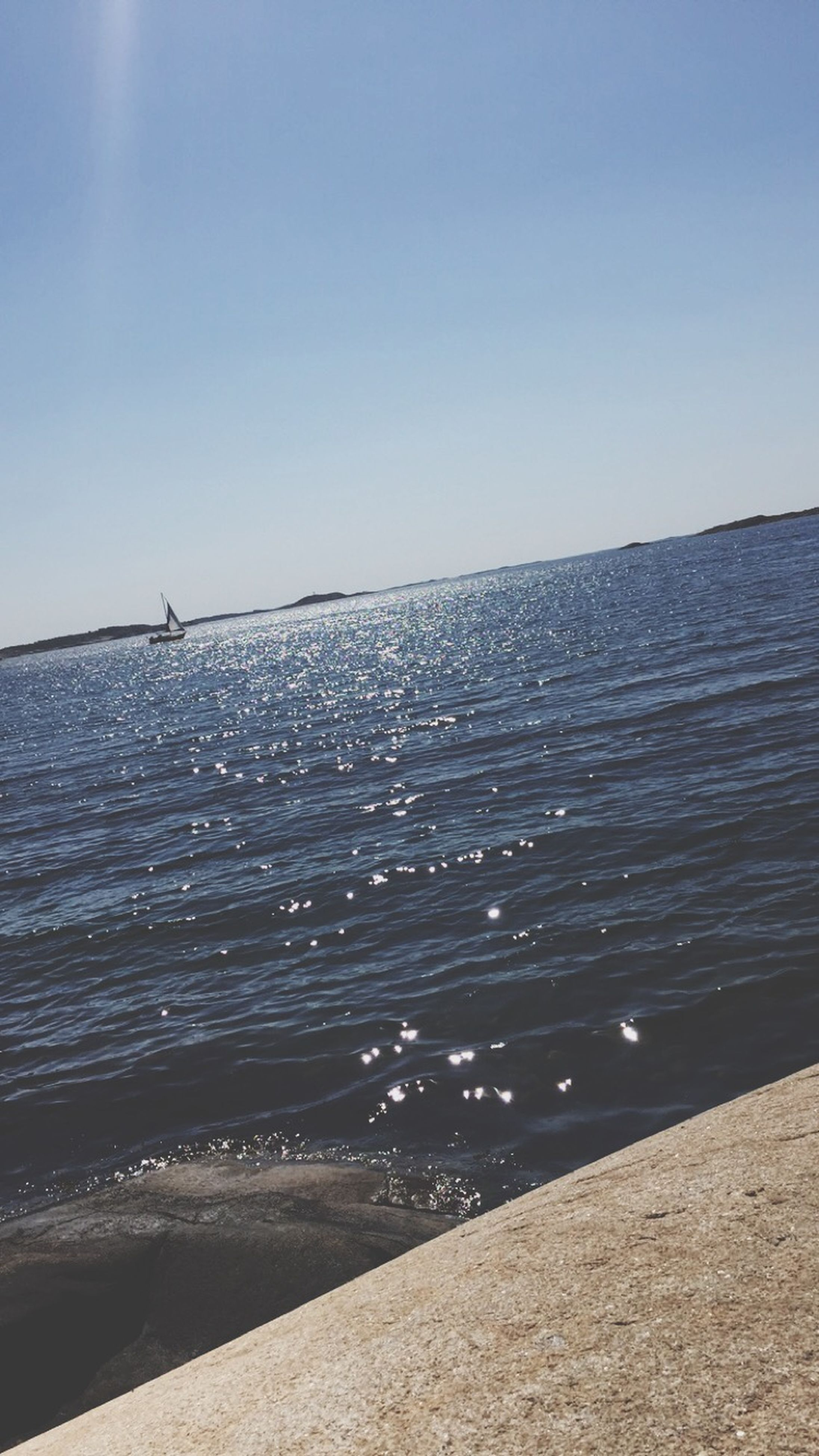 water, sea, clear sky, horizon over water, copy space, tranquil scene, tranquility, scenics, beauty in nature, blue, rippled, nature, sunlight, sky, idyllic, day, outdoors, waterfront, beach, no people