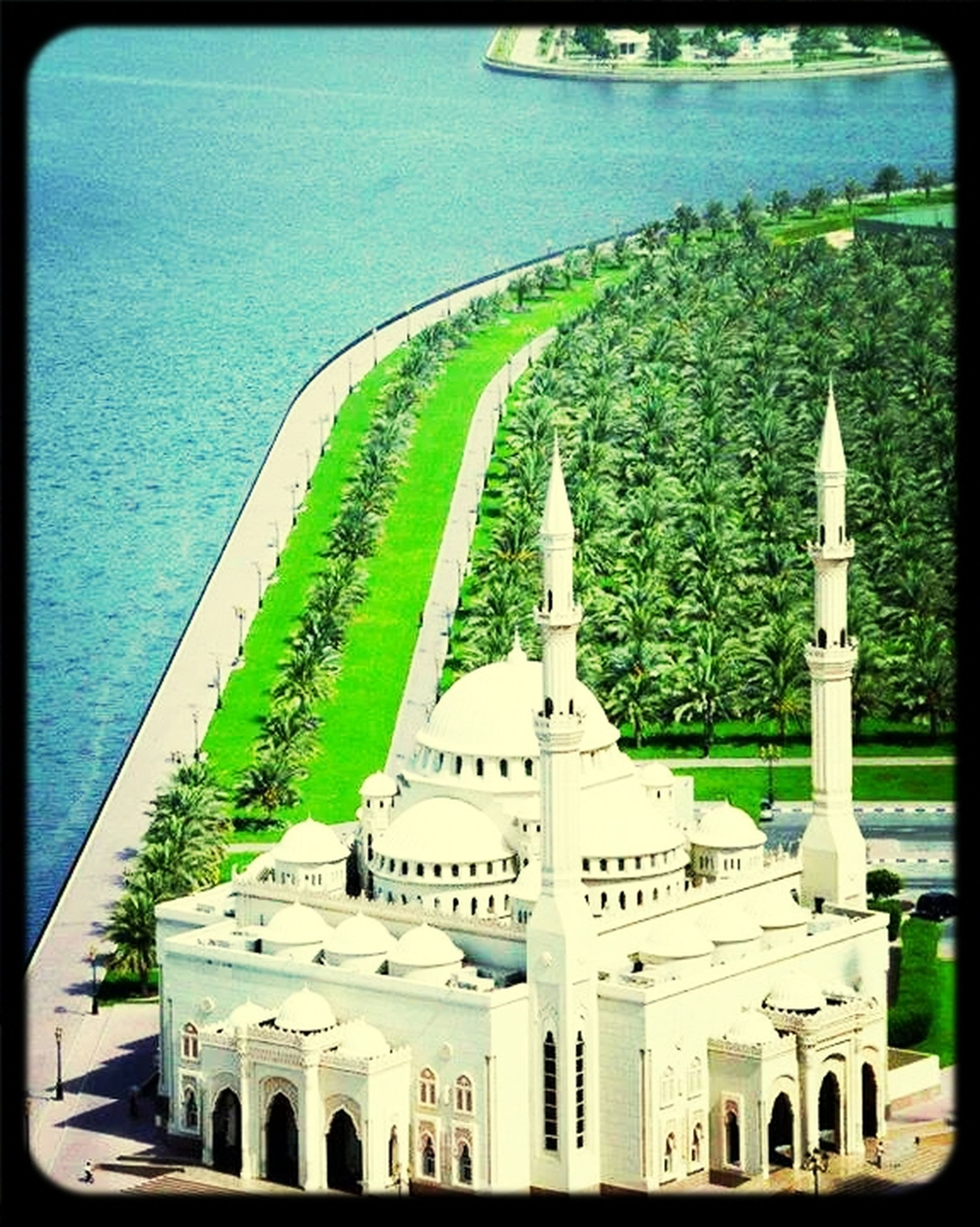 transfer print, architecture, built structure, auto post production filter, water, building exterior, sea, high angle view, green color, day, religion, dome, travel destinations, place of worship, tourism, incidental people, famous place, outdoors, travel, tree