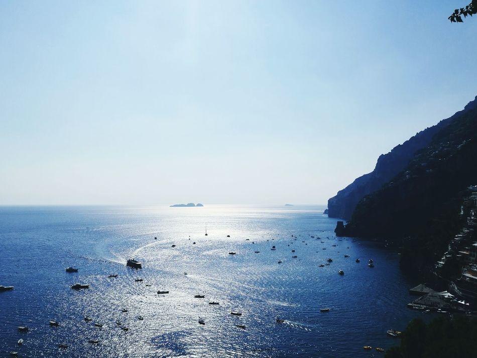 Sea Horizon Over Water Beach Blue Water Sky Outdoors Nature Day Scenics Beauty In Nature Wave Rock - Object No People Amalfi Coast Positano Positano, Italy Boats Sea And Sky Sealife