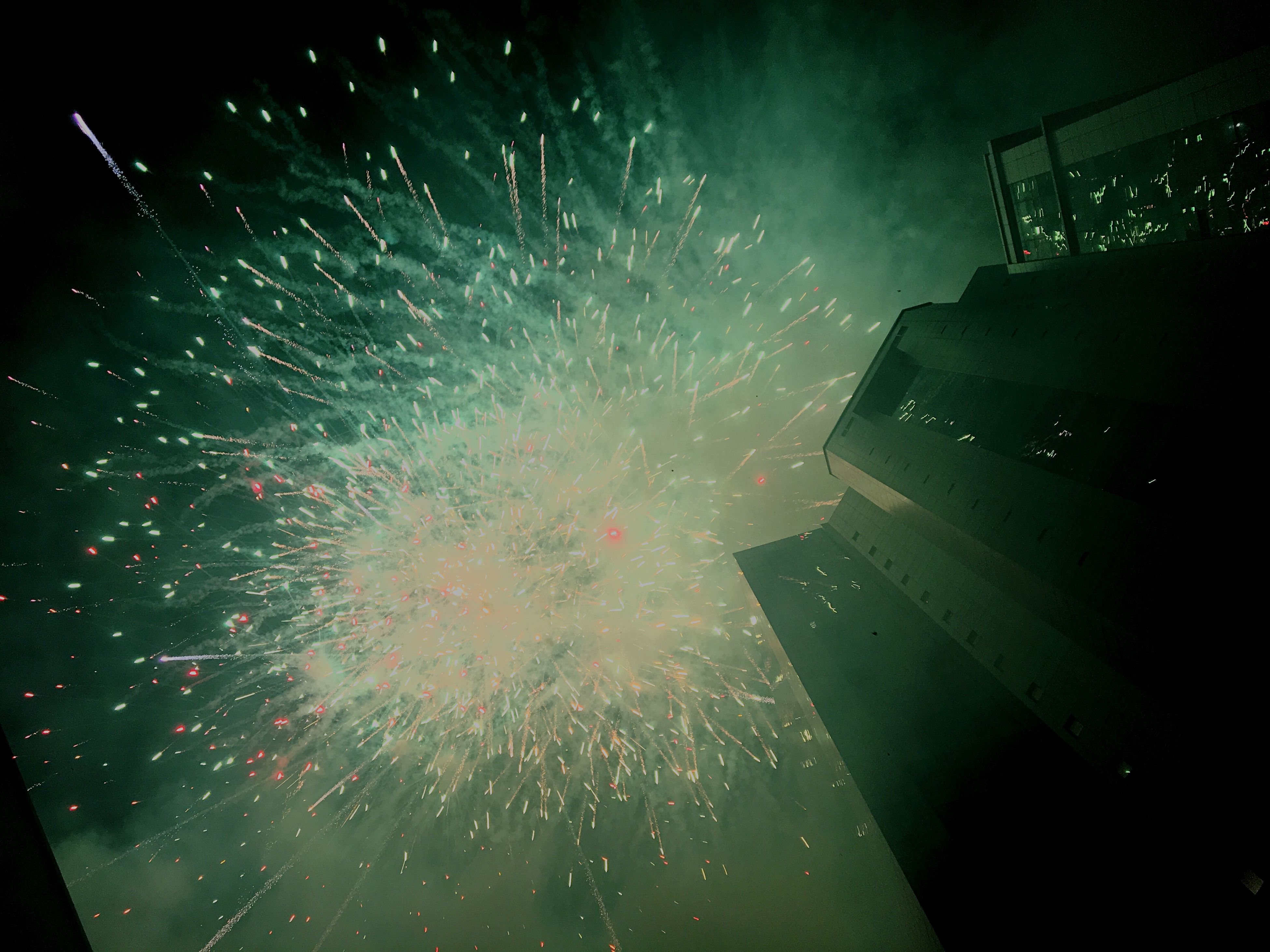 exploding, night, celebration, firework display, destruction, smoke - physical structure, sky, motion, outdoors, no people, firework - man made object, firework