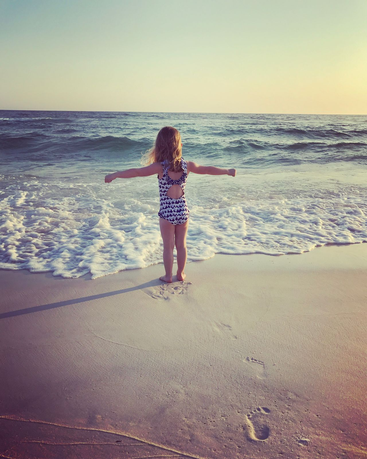 Beach Life Carefree Arms Outstretched Vacations Horizon Over Water Toddler On Beach White Sand Emerald Coast This Week On Eyeem Footprints In The Sand