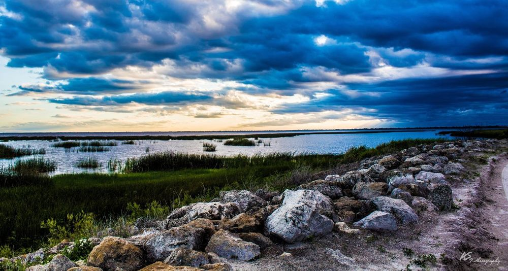 Lake Okeechobee Cloud - Sky Water Sky Nature Rock - Object Scenics Tranquil Scene Tranquility Beauty In Nature Landscape No People Outdoors Sea Horizon Over Water Travel Destinations Grass Day