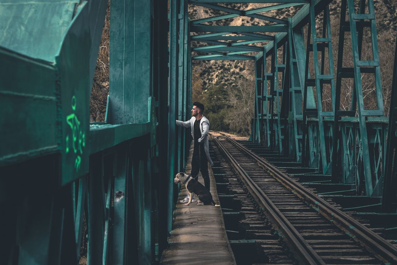 Full Length Real People One Person Lifestyles Men Rail Transportation Railroad Track Leisure Activity The Way Forward Rear View Outdoors Businessman Day Young Adult