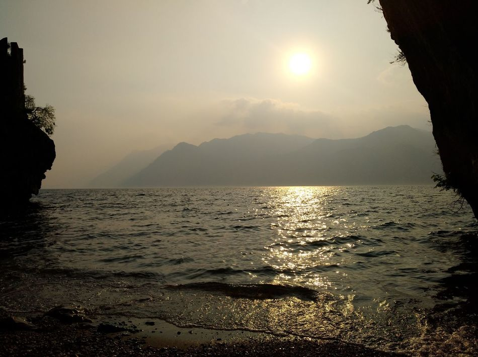 Water Sea Nature Sun Outdoors Landscape Sunlight Tranquility Scenics Sunset Sundown Summer Beach Vacations Beauty In Nature Horizon Over Water Adventure Sky Day Relaxing We Are Eyeem, We Are Photography We Are Photography, We Are EyeEm My View From Here Lake Garda StillLifePhotography