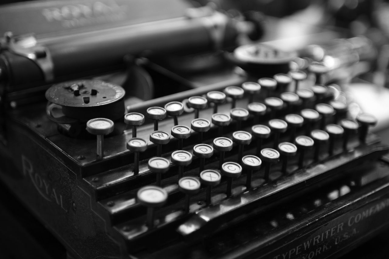 typewriter, old-fashioned, text, antique, retro styled, technology, high angle view, alphabet, indoors, no people, close-up, communication, machinery, cash register, keyboard, day