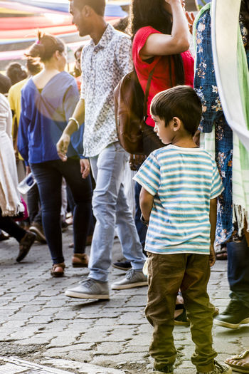 innocence in crowd.... Kalaghoda Festival Kala Ghoda Art Fest Kalaghodaartfestival Kid Streetphotography Street Photography Fun Boys Men Casual Clothing Togetherness Enjoyment Outdoors Day Motion Child Childhood People Large Group Of People Young Adult