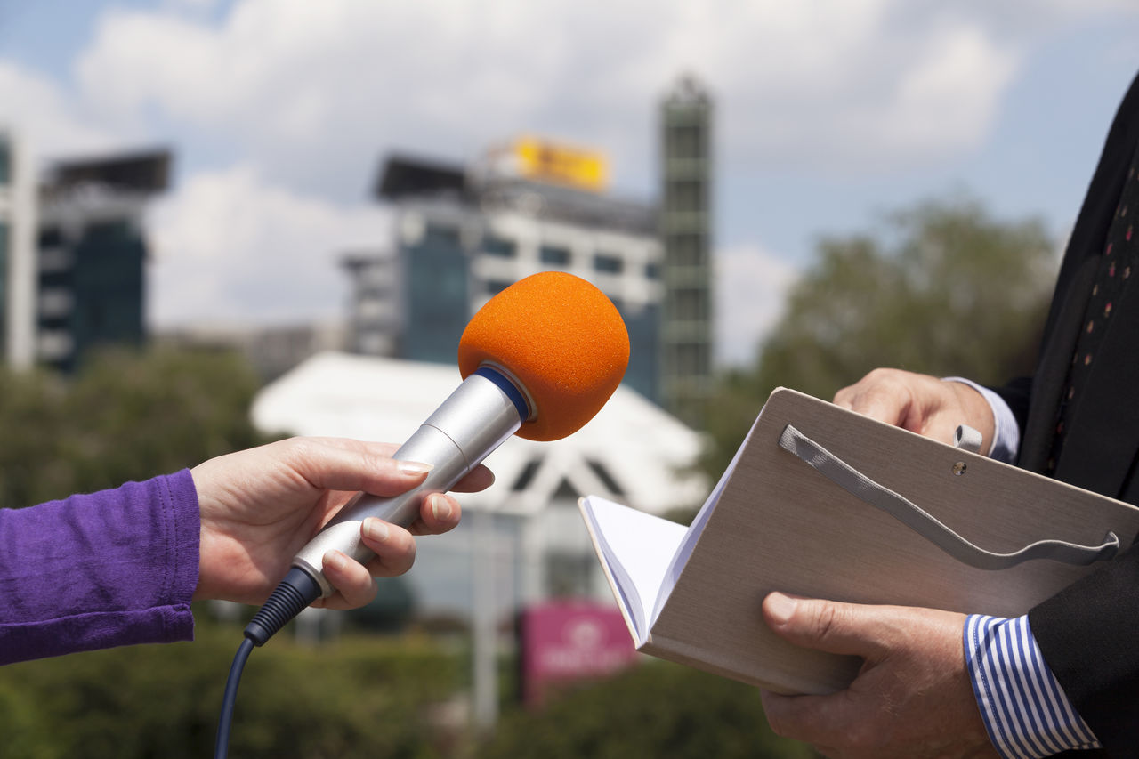 Journalist making media interview with businessman Adult Audio Broadcasting Businessman City Close-up Communication Day Hand Holding Holding Hands Human Hand Inteview Journalist Media Men Microphone Only Men Outdoors People Politician Press Sky Technology