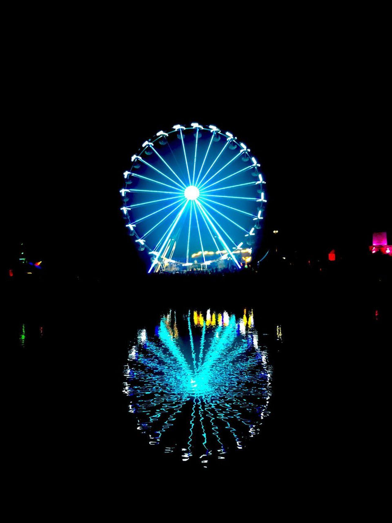 Illuminated Night Arts Culture And Entertainment Multi Colored Long Exposure Amusement Park Celebration No People Ferris Wheel Sky Clear Sky Outdoors