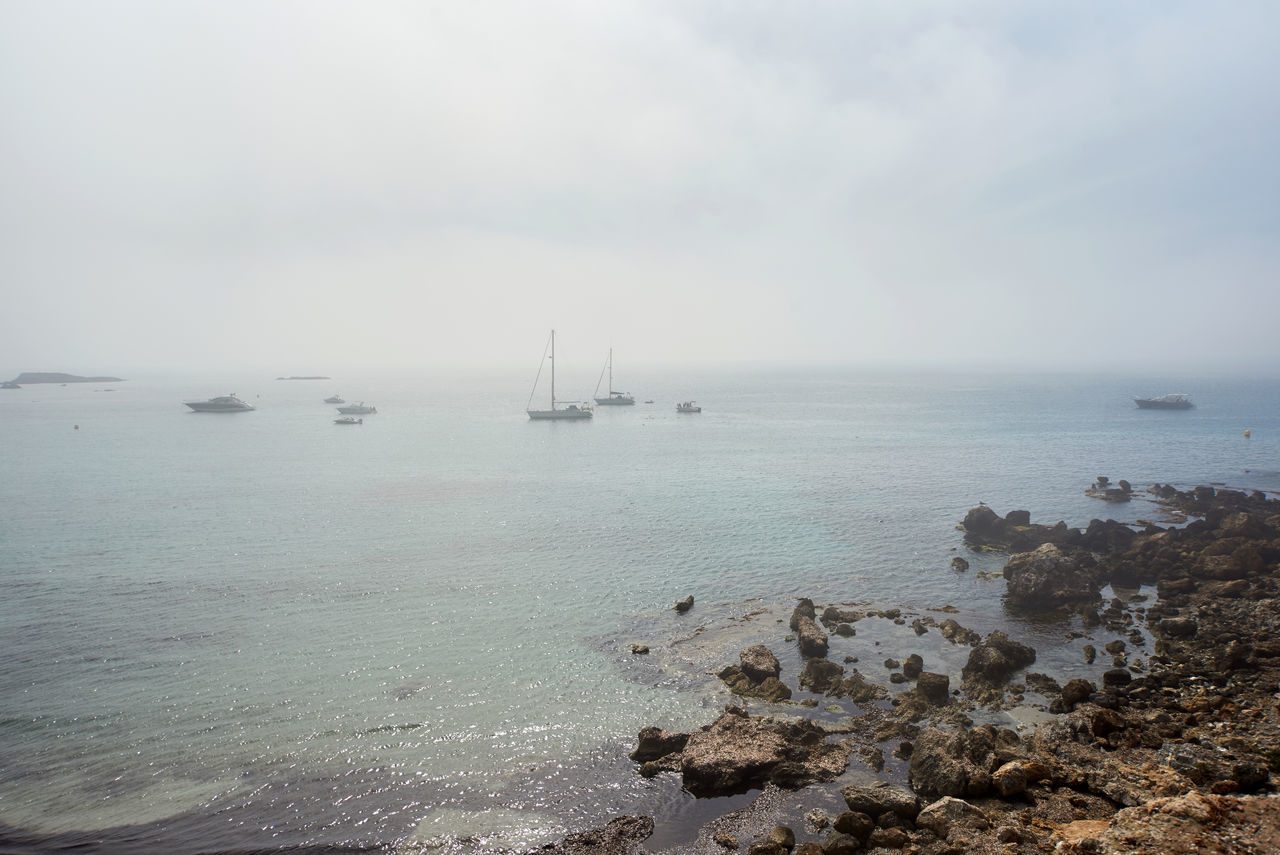 sea, water, tranquility, horizon over water, scenics, nature, sky, beauty in nature, tranquil scene, outdoors, day, no people, nautical vessel, waterfront, transportation, fog