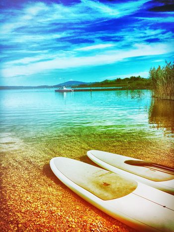 Water Tranquil Scene Tranquility Lake Sky Scenics Transportation Blue Rowboat Travel Destinations Boat Reflection Tourism Cloud Mountain Rippled Riverbank Beauty In Nature Vacations