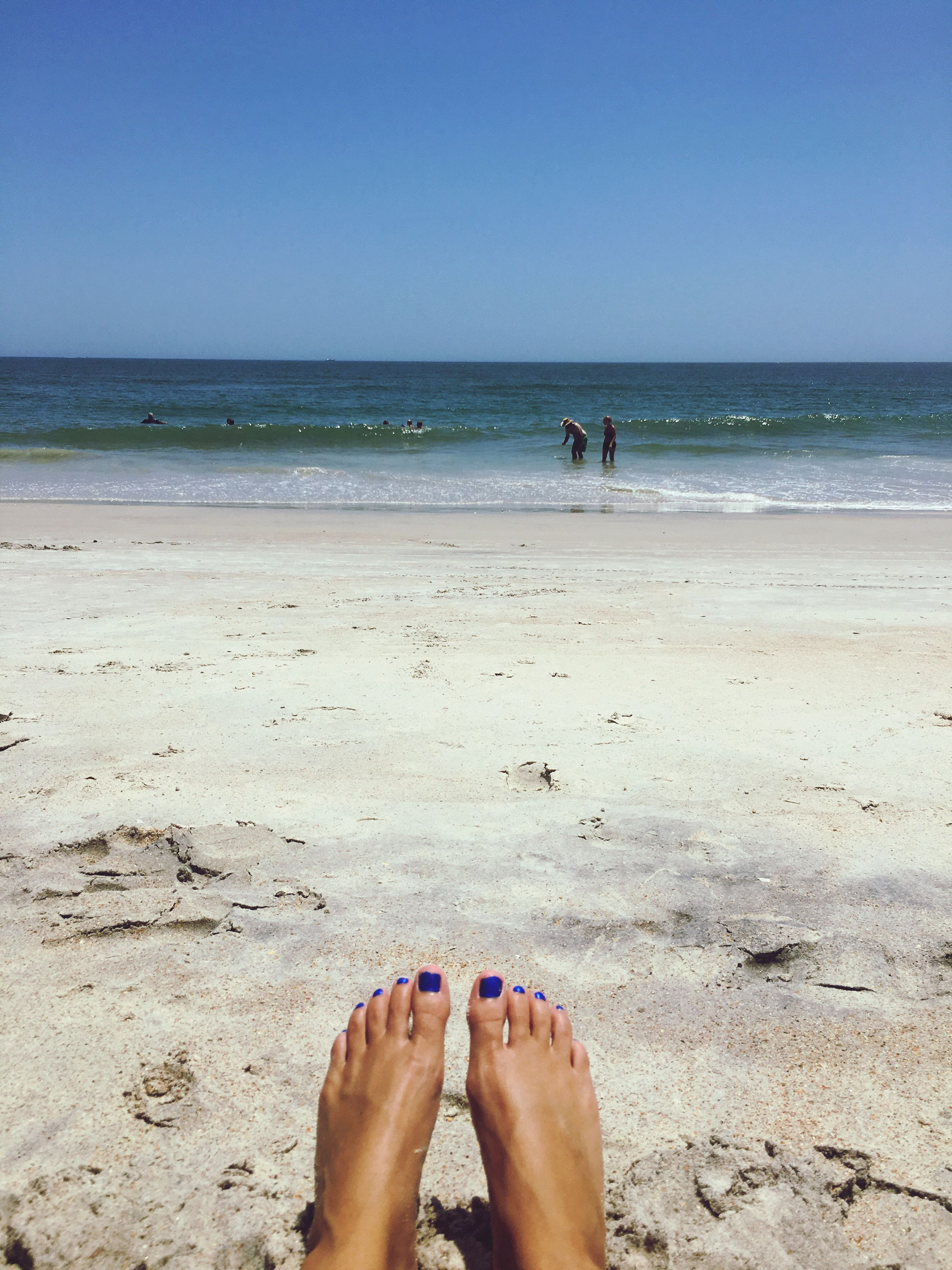 sea, beach, water, horizon over water, sand, real people, shore, scenics, barefoot, clear sky, day, nature, one person, blue, men, low section, human leg, leisure activity, beauty in nature, outdoors, sky, lifestyles, vacations, people