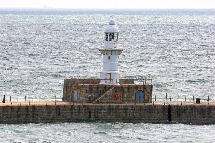 Defense structure of Dover port IV Defense Direction Dover Dover Harbor Dover P Fresh On Eyeem  Guidance Horizon Over Water Light Lighthouse Military Nature No People North Sea Outdoors Protection Rippled S Safety Sea Security Water Water Reflections Showcase June