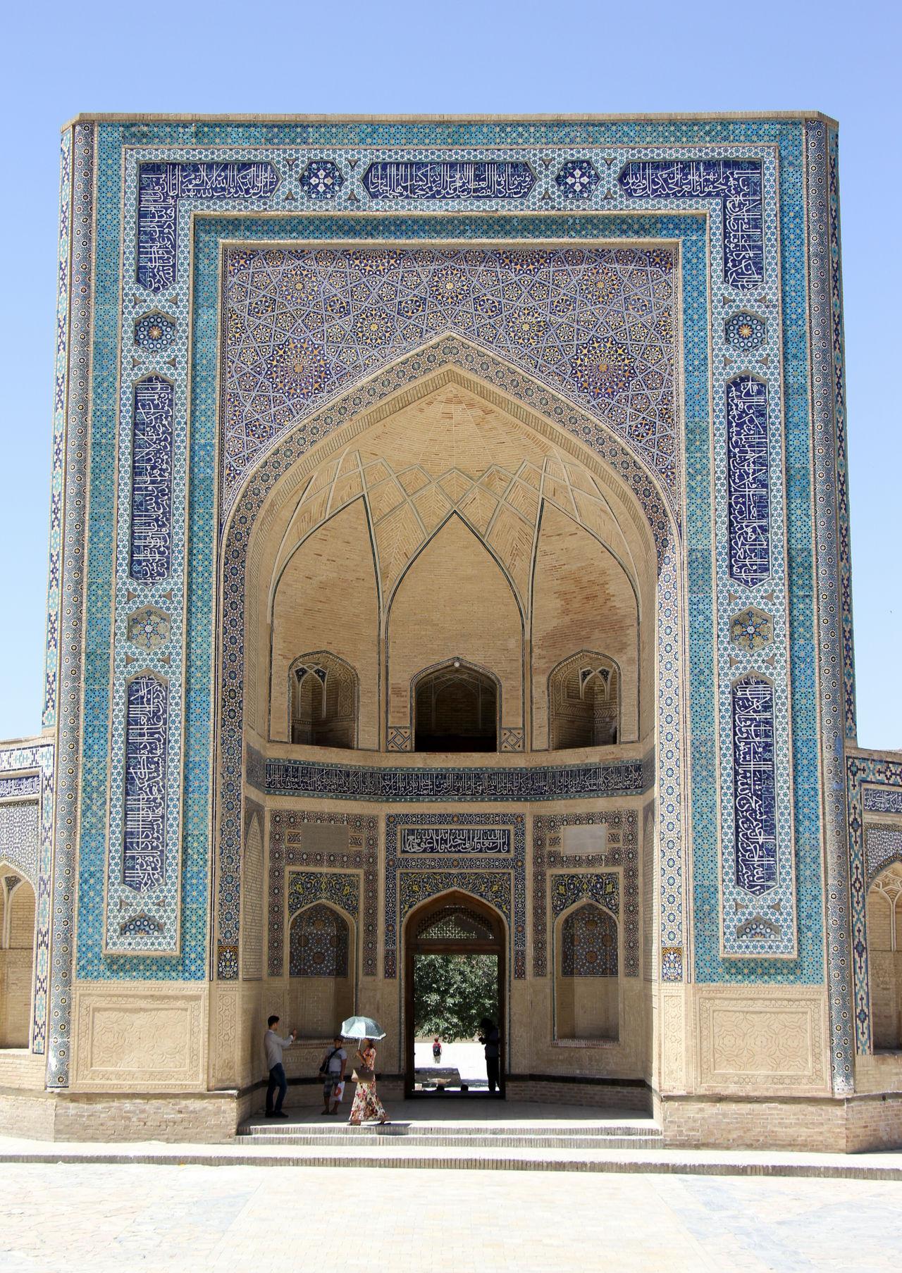 Adult Arch Architecture Built Structure Bukhara Day Islamic Islamic Architecture Islamic Art Madrassa Only Men Outdoors People Silk Road Sitting Travel Destinations Uzbekistan