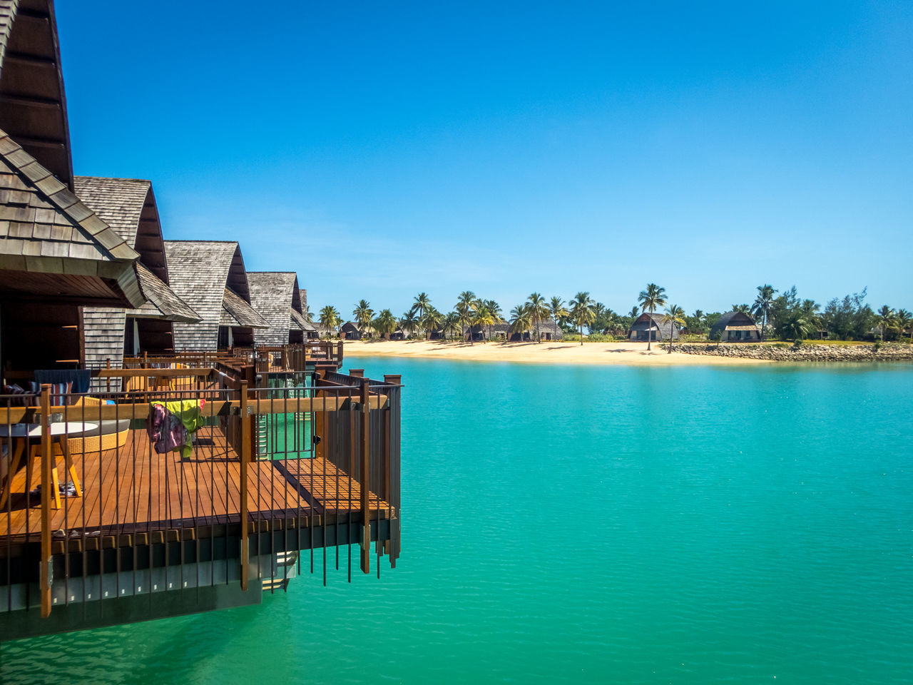 Lined up (3) Architecture Blue Building Exterior Built Structure Bure Clear Sky Day Fiji Holiday Villa Lagoon Lagoon Water Nature No People Outdoors Over Water Overwater Bungalow Scenics Sea Sky Tree Water