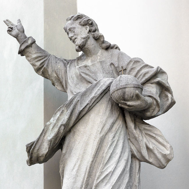 Statue of God; in his hand he holds the planet Earth. Angel Apostles Art Carving - Craft Product Catholic Catholicism Christ Christianity Church Cross Crucifixion Faith Faithful God Holy Human Representation Jesus Prayer Religion Sacred Saint Sculpture Spiritual Statue Symbol