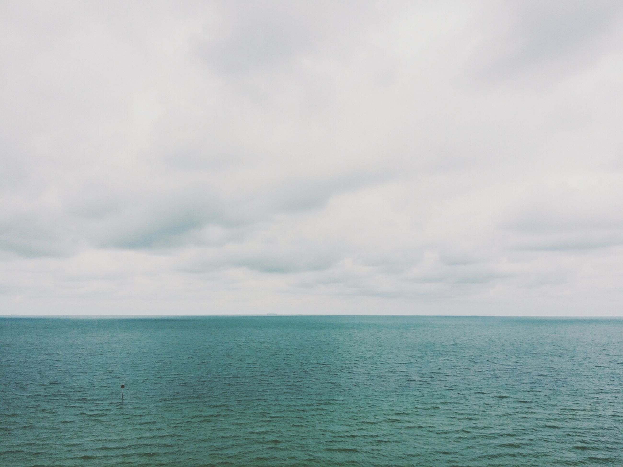 sea, sky, horizon over water, water, tranquil scene, waterfront, scenics, tranquility, beauty in nature, cloud - sky, nature, cloudy, idyllic, cloud, seascape, rippled, overcast, outdoors, day, weather