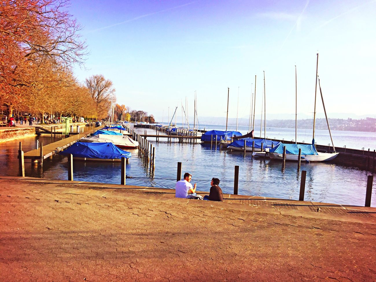 Water Real People Sky Outdoors Two People Beauty In Nature Nature Tree Lake Züri Blue Zürich Zurich, Switzerland Zurichlake Lakezurich Pier Sailing Boat