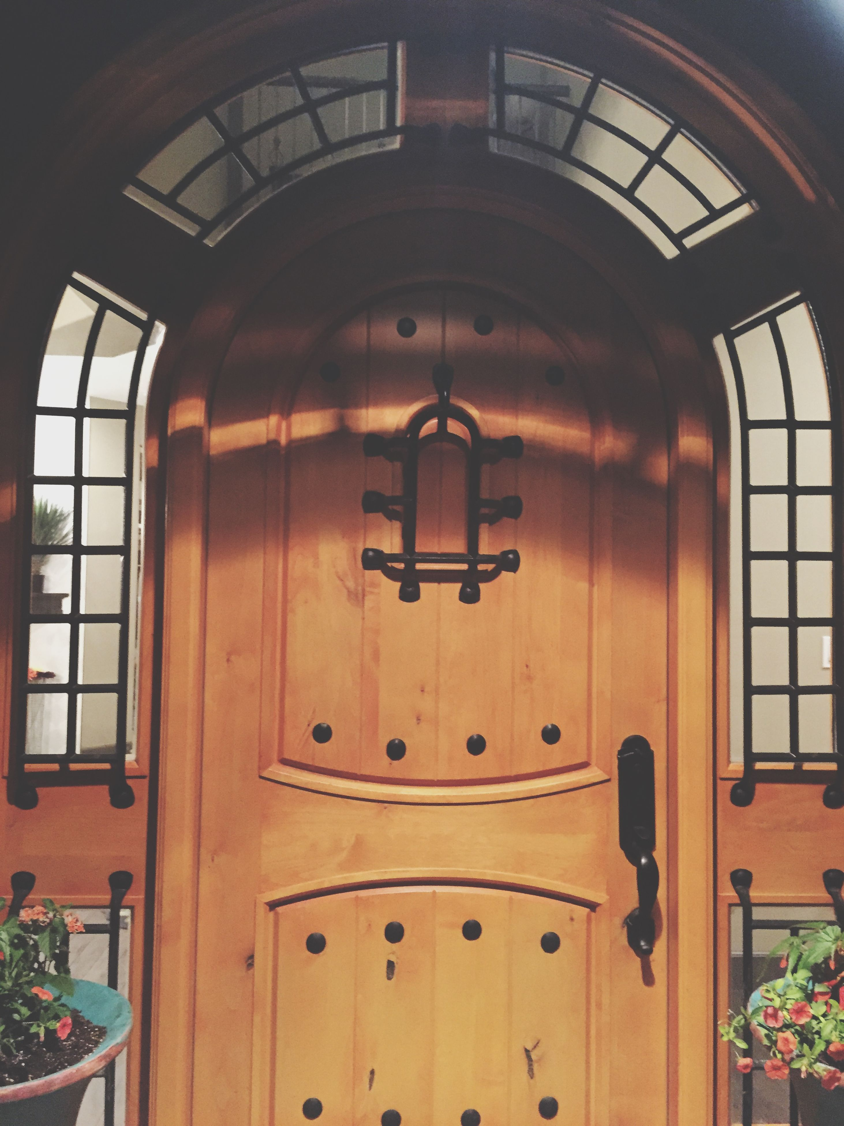 door, architecture, built structure, closed, wood - material, building exterior, house, entrance, safety, protection, arch, window, red, security, wooden, no people, day, old, wood, outdoors