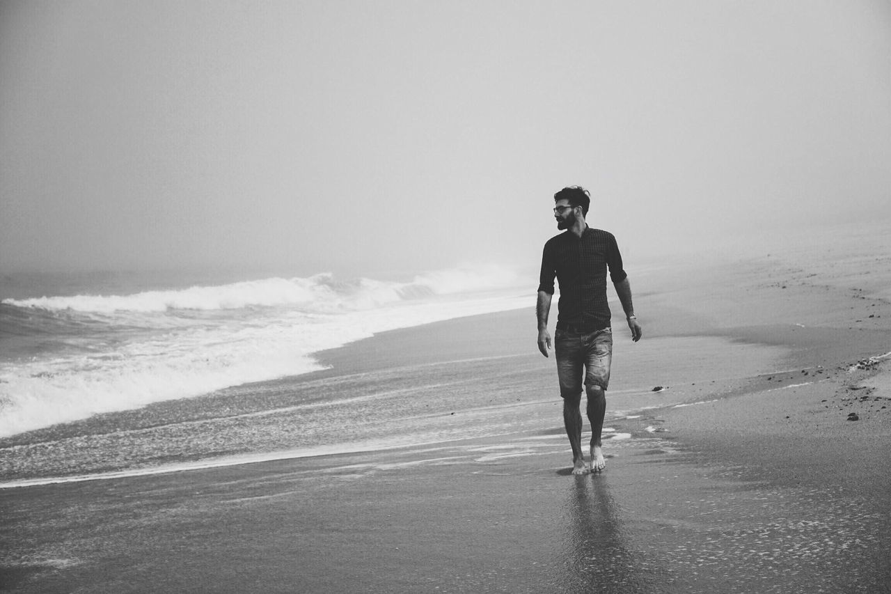 Good Morning Beach Beach Photography Beach Walk Sea Full Length Real People Sand One Person Lifestyles Horizon Over Water Nature Front View Wave Outdoors Water Vacations Travel Destinations Monochrome Foggy Morning Fog Blackandwhite Men Holiday