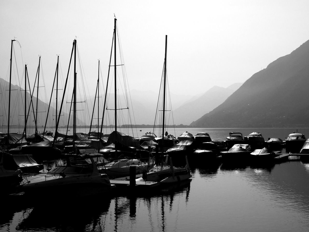 At Porto Patriziale on Lago Maggiore in Ascona, Ticino, Switzerland Alps Beauty In Nature Blackandwhite Bnw Clear Sky Day Harbor In A Row Lake Mast Mode Of Transport Moored Mountain Nature Nautical Vessel No People Outdoors Scenics Sky Switzerland Ticino Tranquility Transportation Water