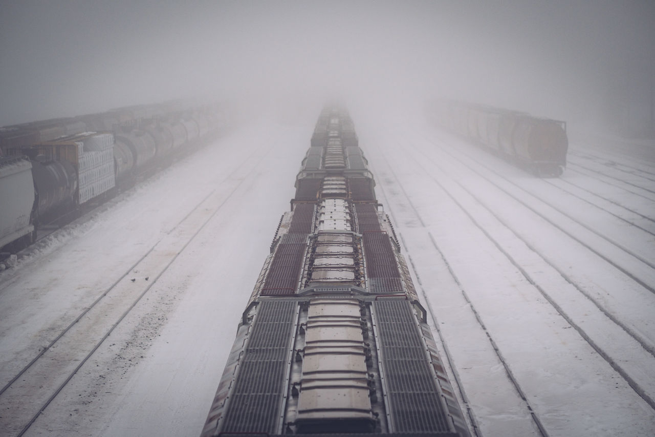 Cold Temperature Day Fog No People Outdoors Snow Snowing Tracks Train Yard Trains Vanishing Vanishing Point Weather Winter