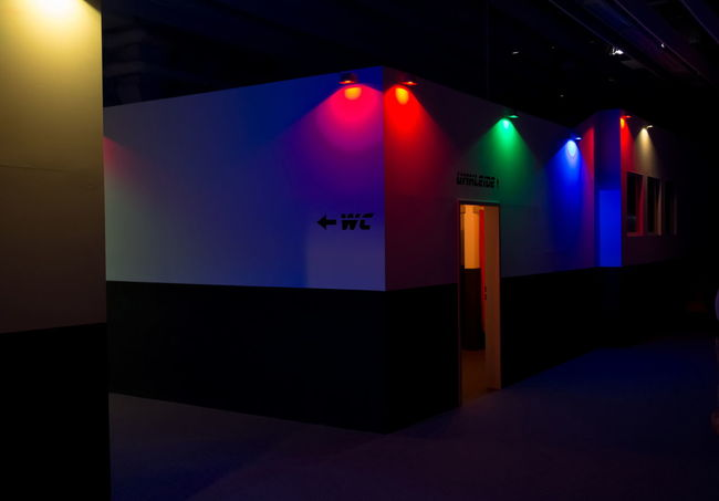 Coloful Lights in a Lasertag Club Arts Culture And Entertainment Blue Color Light Colorful Dark Door Dressing Room Fitting Room Green Illuminated Indoors  Lasertag Neon Lights Red Red Light Sport Studio Shot Text Toilette Wall Wc