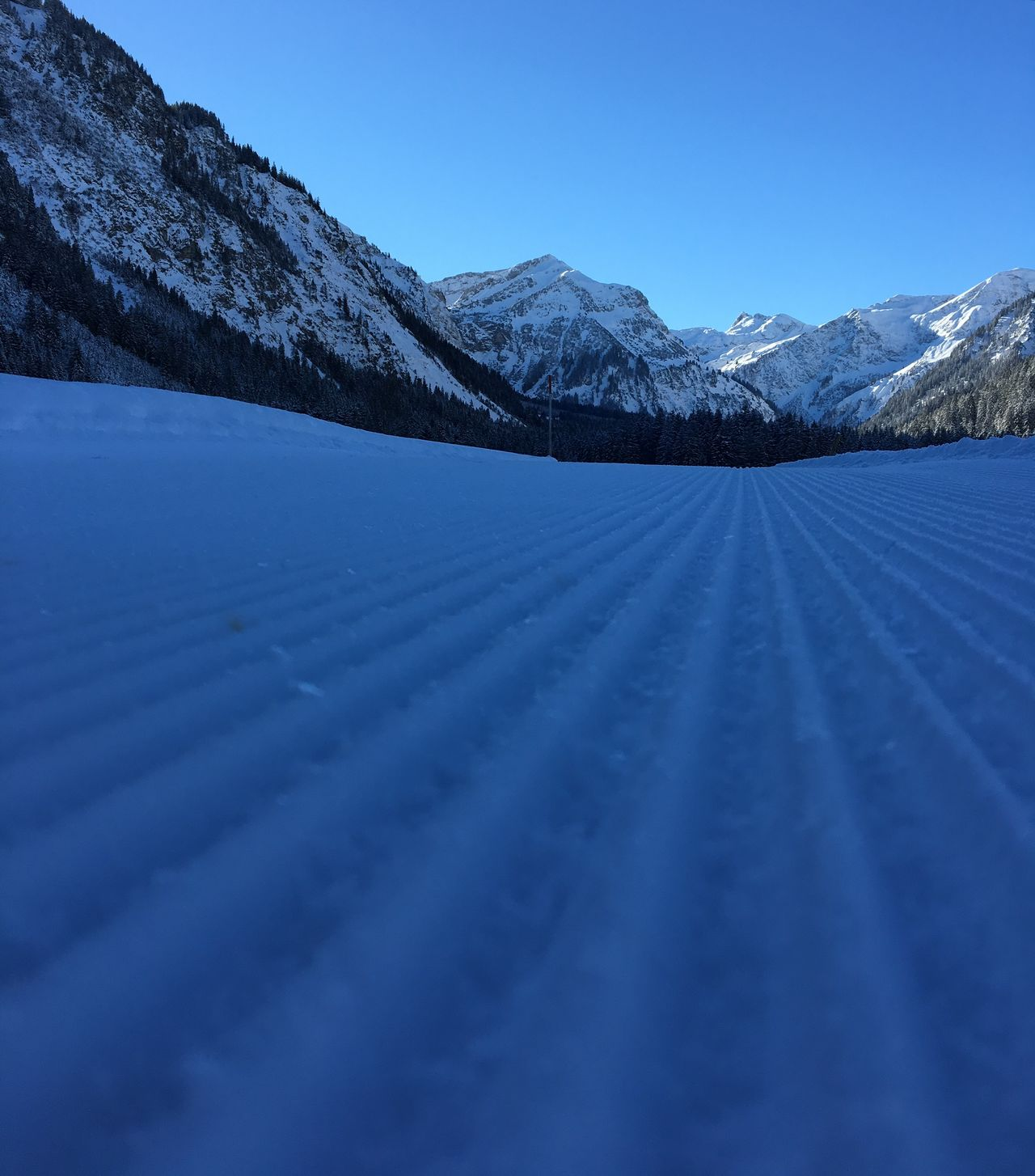 freshly groomed slope :-) Beauty In Nature Blue Cold Temperature Cross Country Skiing Early Morning I Love Snow Landscape Mountain Nature No People Outdoors Piste Race Scenics Skating Skiing Sky Slope Snow Snowshoeing Sports Unspoiled Winter Wintersport Wintersportarea