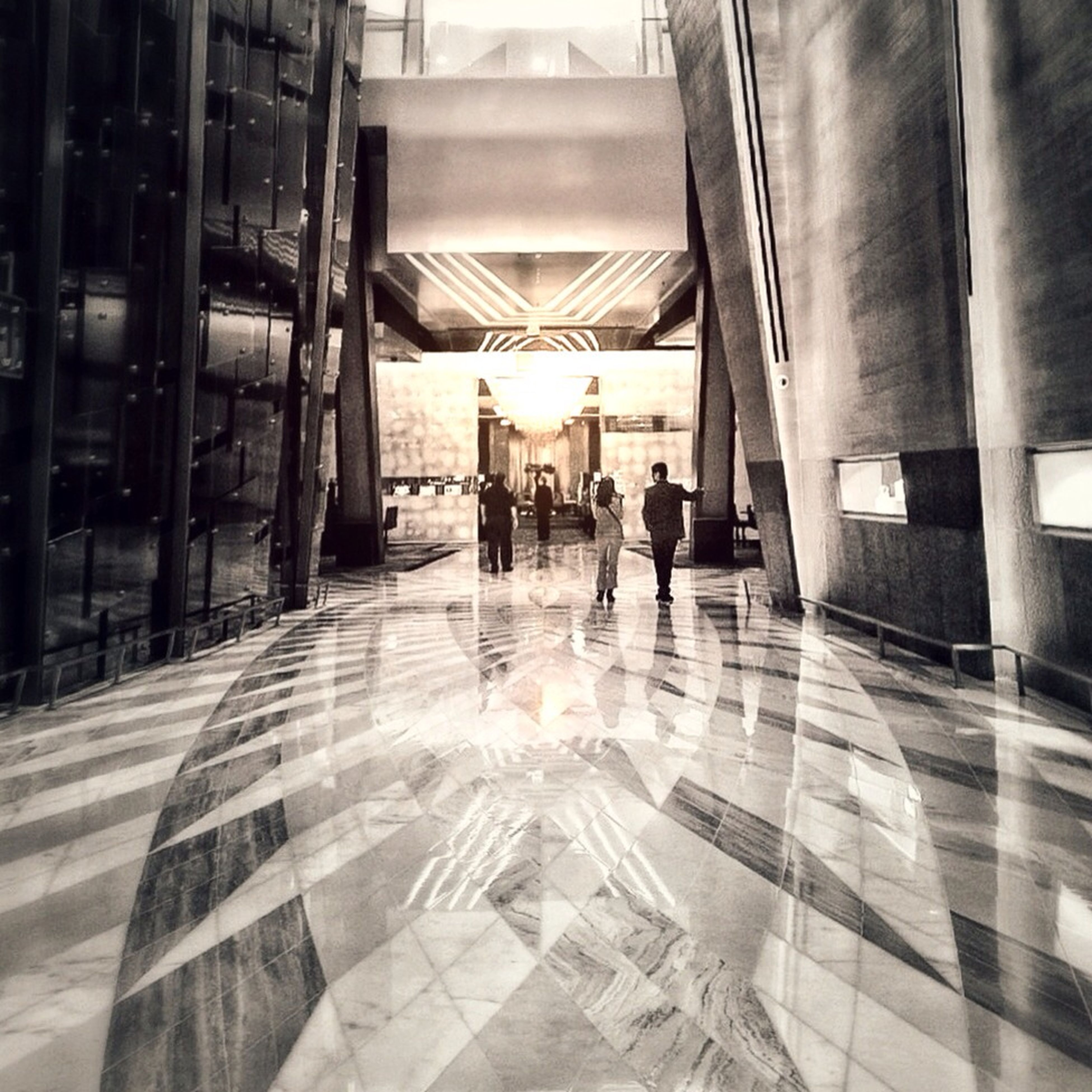architecture, indoors, built structure, men, person, architectural column, lifestyles, walking, ceiling, corridor, the way forward, column, tiled floor, leisure activity, flooring, full length, incidental people, city life, building